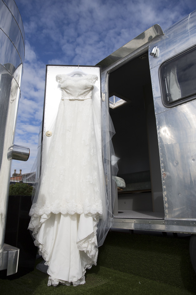 close up of wedding dress hanging on retro rocket at Brook's Guest House in Bristol