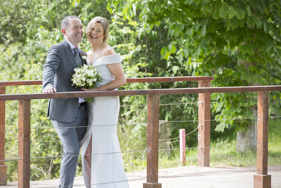 bride and groom on the bridge at the Weald of Kent in Headcorn