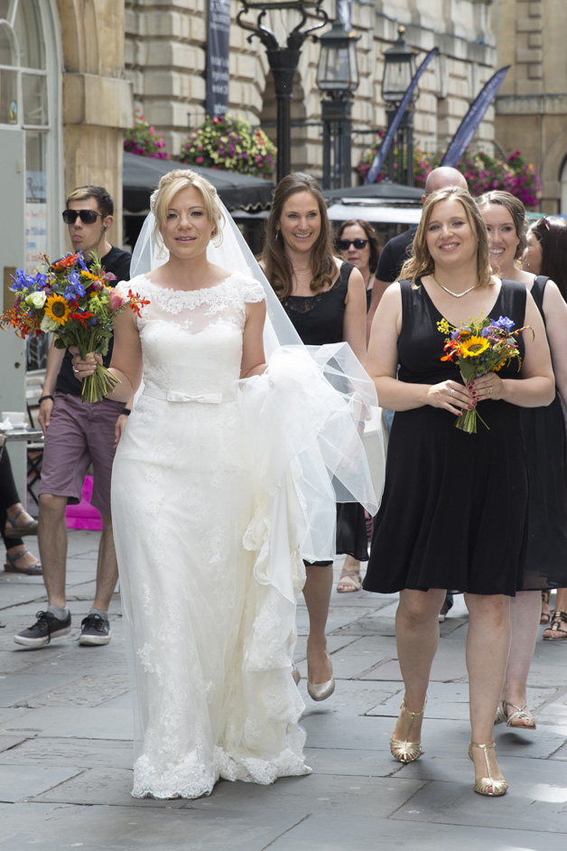bride with bridesmaids walking through highstreet to Bristol Register Office