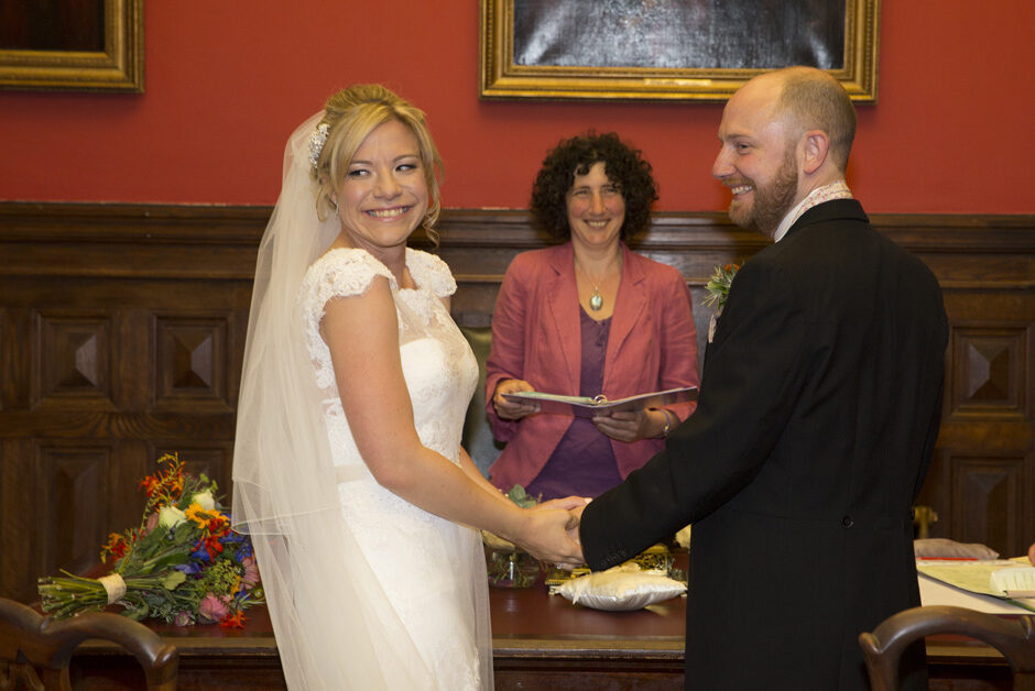 bride and groom laughing when asked if anyone objects during wedding ceremony at Bristol Register Office