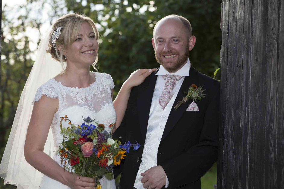 bride and groom enjoying a relaxing moment outdoors at Bristol Emporium
