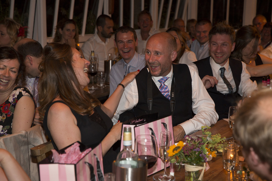 bridesmaid laughing with her husband at Victoria's Secret gift from bride at Bristol wedding reception at The Ethicurean