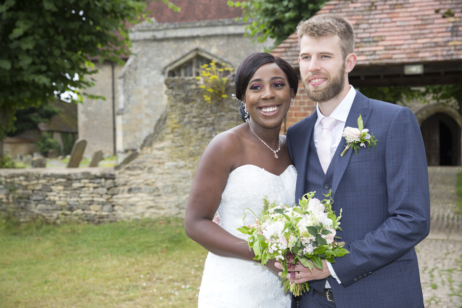 bride and groom portrait outside church xx in Buckinghamshire