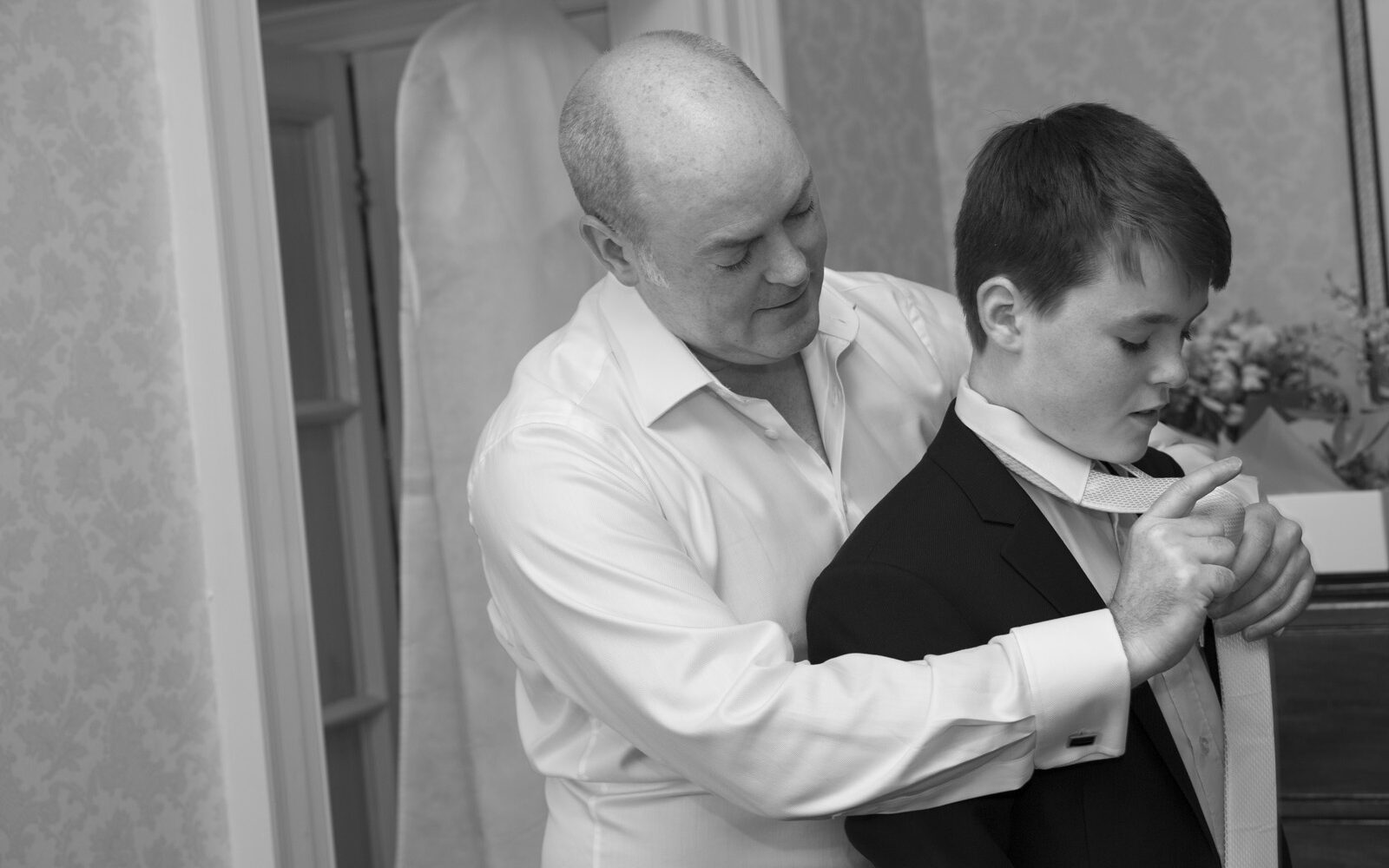 groom helping his son with his tie getting ready at The Shelleys in Lewes