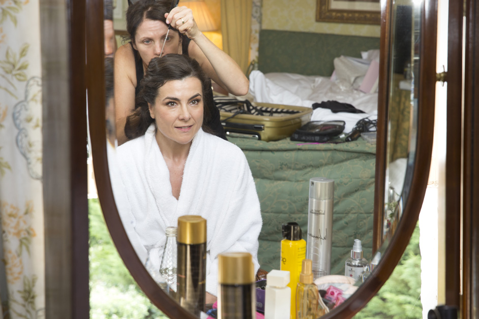 Bride looking in the mirror getting ready at The Shelleys in Lewes