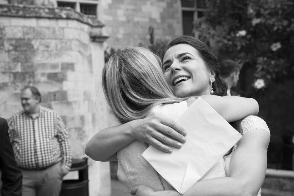 bride shares a loving embrace with a friend just after her wedding ceremony at Lewes Register Office