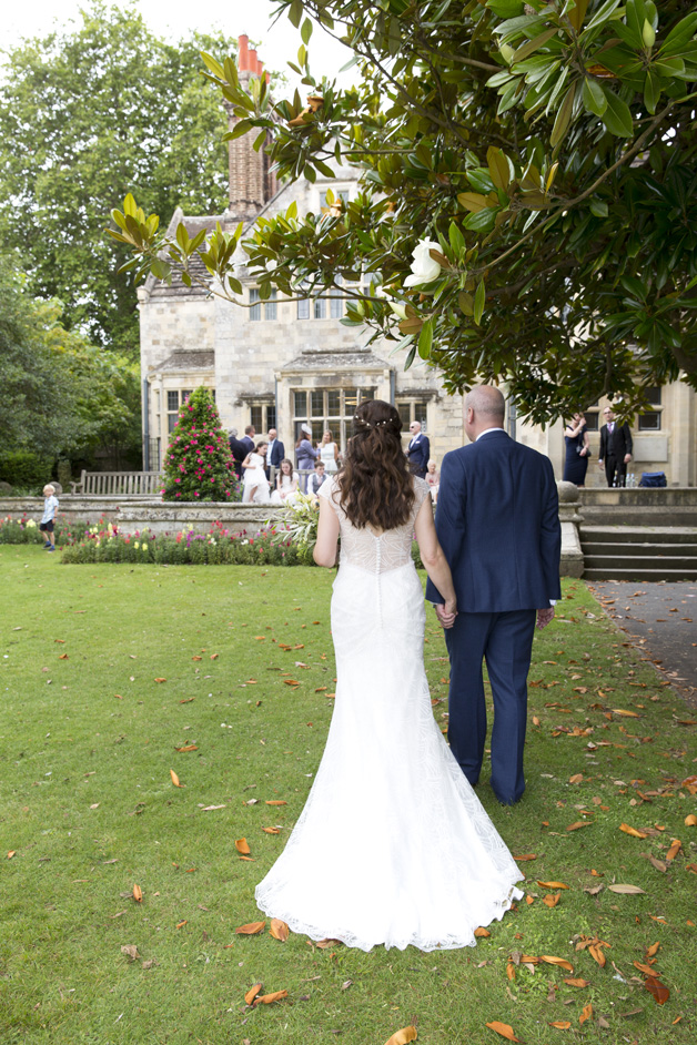 bride and groom walk towards their guests after their wedding ceremony at Lewes Register Office