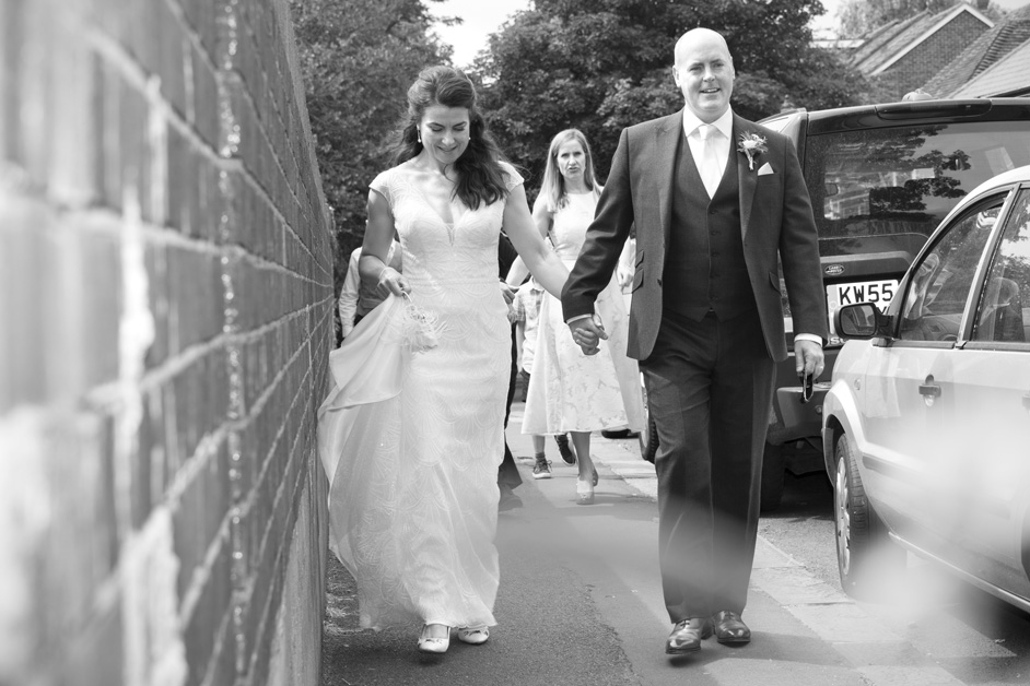 bride and groom walking through Lewes after their wedding ceremony at Lewes Register Office