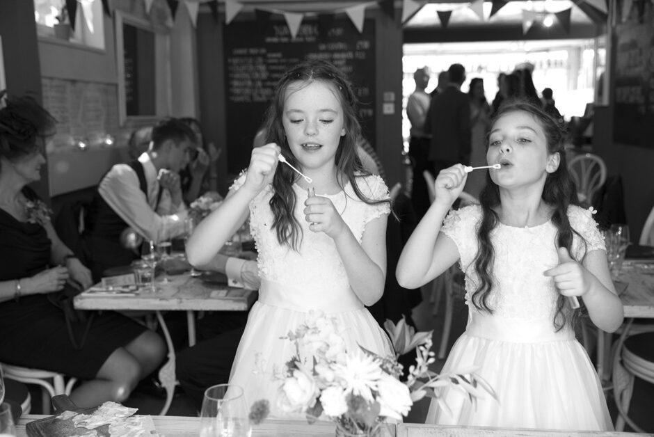 bridesmaids blowing bubbles at Lewes wedding at Limetree Kitchen