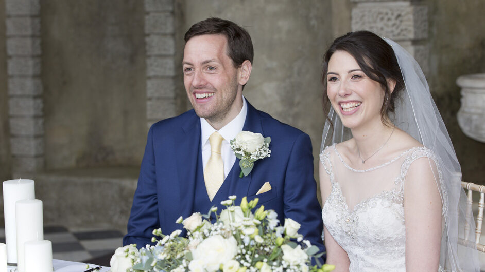 bride and groom laughing at outdoor ceremony at Wotton House wedding in Dorking, Surrey