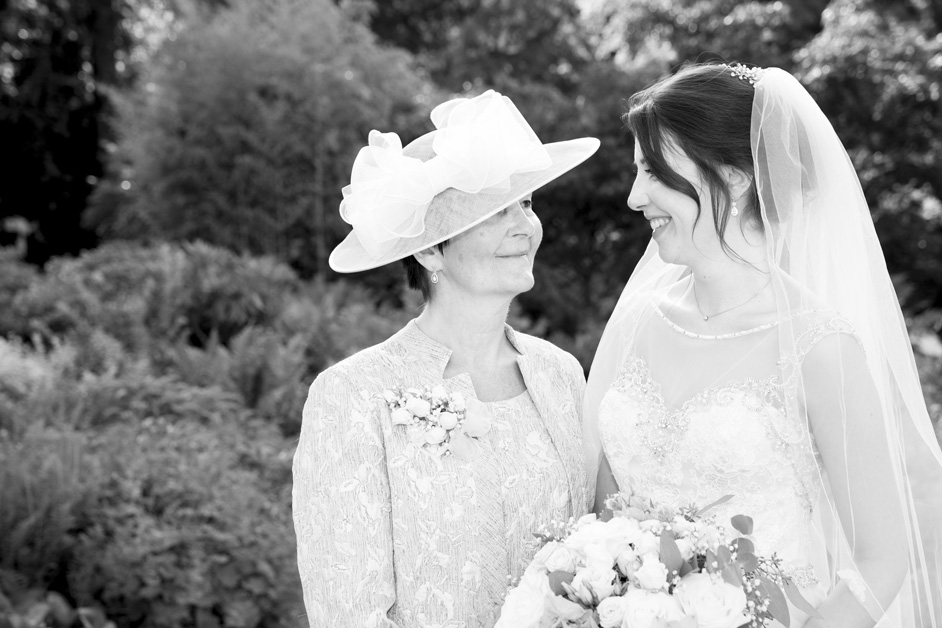 beautiful loving glance between mother and bride at Wotton House wedding in Dorking, Surrey