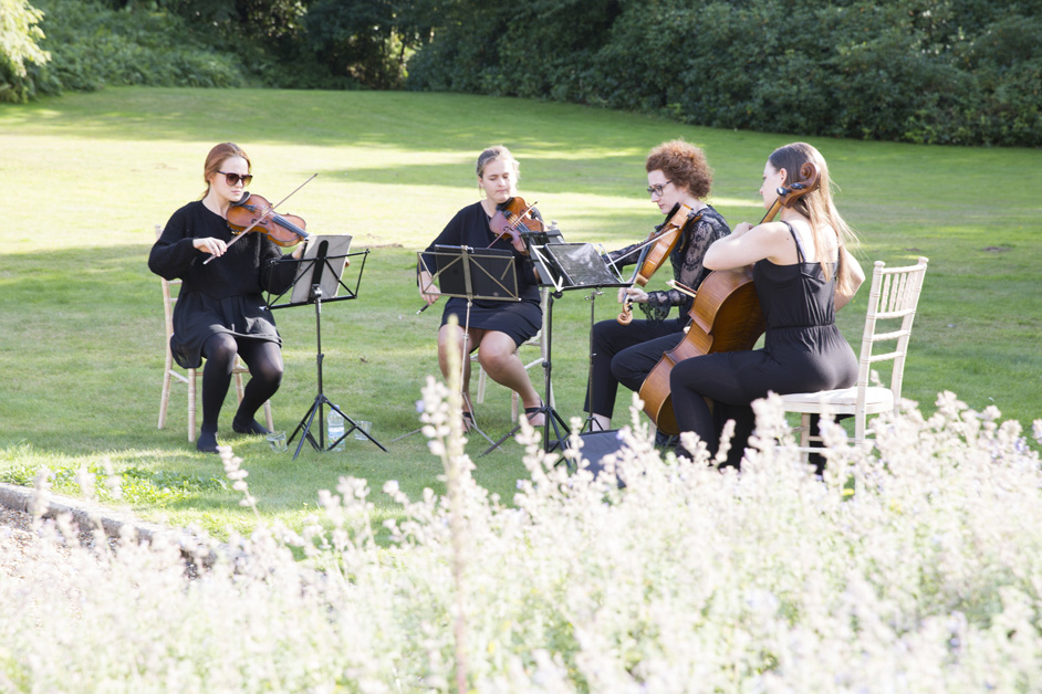 string quartet playing in the grounds at Wotton House wedding in Dorking, Surrey
