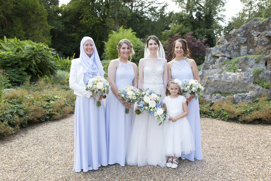 bride with bridesmaids at Wotton House wedding in Dorking, Surrey