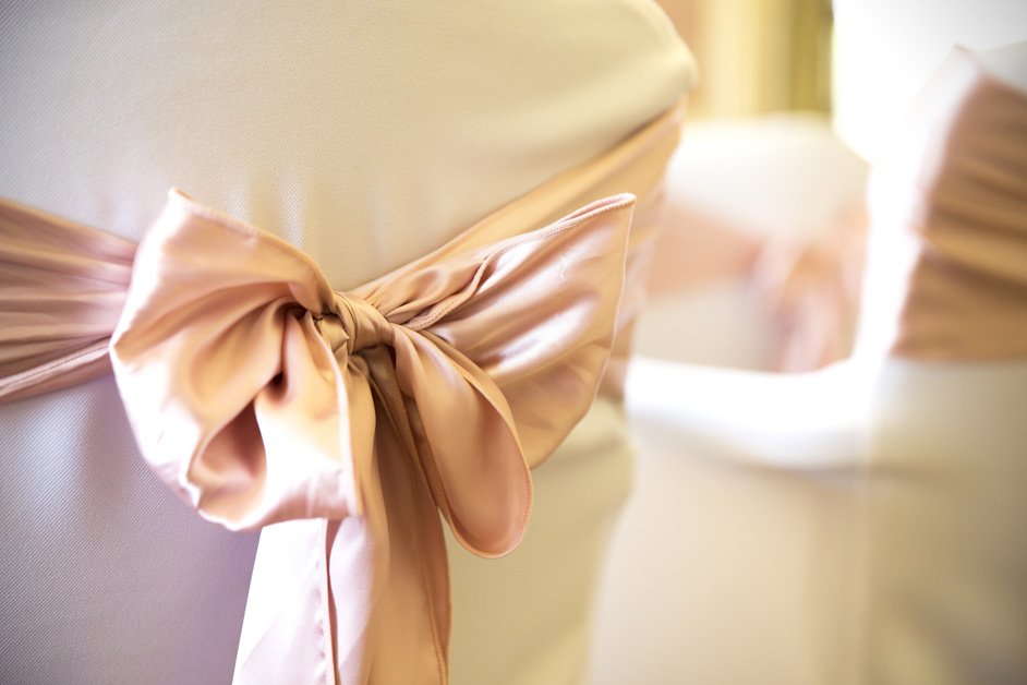 tied pink bows around ceremony chairs at Stoke Park wedding in Reading