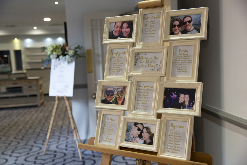 table plan picture frame of holiday destinations at Wotton House wedding in Dorking, Surrey