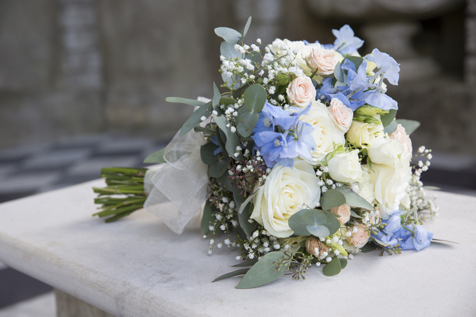 bride's bouquet in mock Roman temple at Wotton House wedding in Dorking, Surrey
