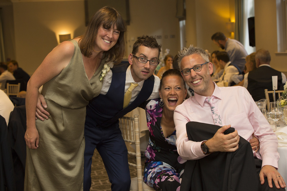 guests having a laugh before wedding breakfast at Wotton House in Dorking, Surrey