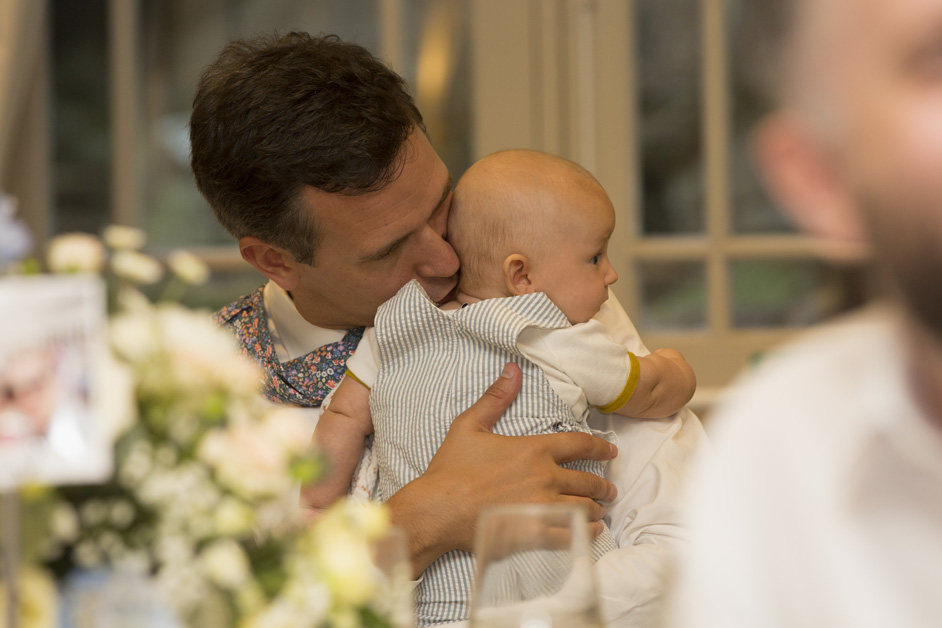 father and baby having a cuddle at Wotton House wedding in Dorking, Surrey