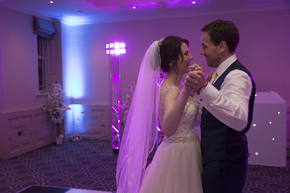 bride and groom looking at each other lovingly during first dance at Wotton House wedding in Dorking, Surrey