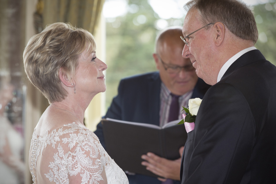 bride and groom looking at each other during vows at Stoke Park, Reading