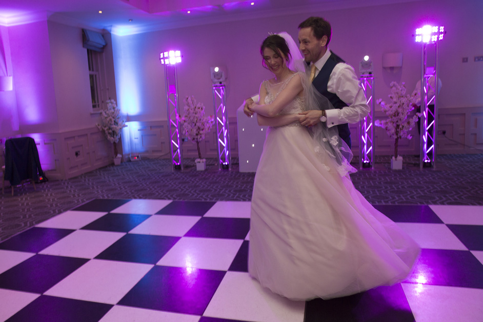 bride and groom dance routine at Wotton House wedding in Dorking, Surrey