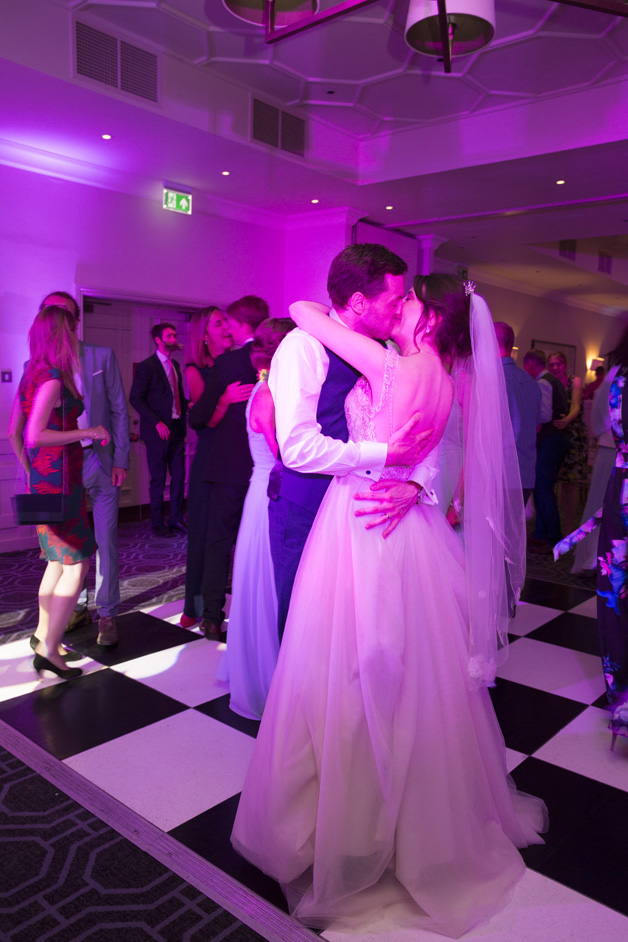 bride and groom kissing on the dance floor at Wotton House wedding in Dorking, Surrey