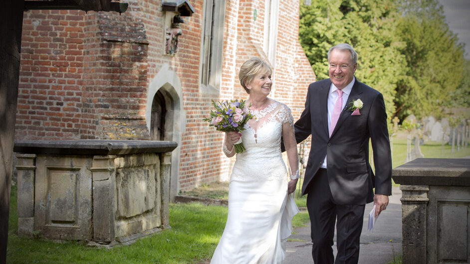 bride and groom walking into Stoke Poges Church in Reading