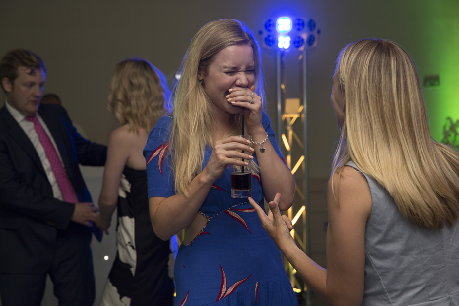 female guests laughing her head off on dance floor at Wotton House wedding in Dorking, Surrey