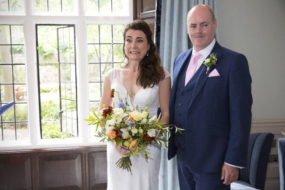bride and groom pulling a funny face when asked if anyone objects to them getting married at Lewes Register Office