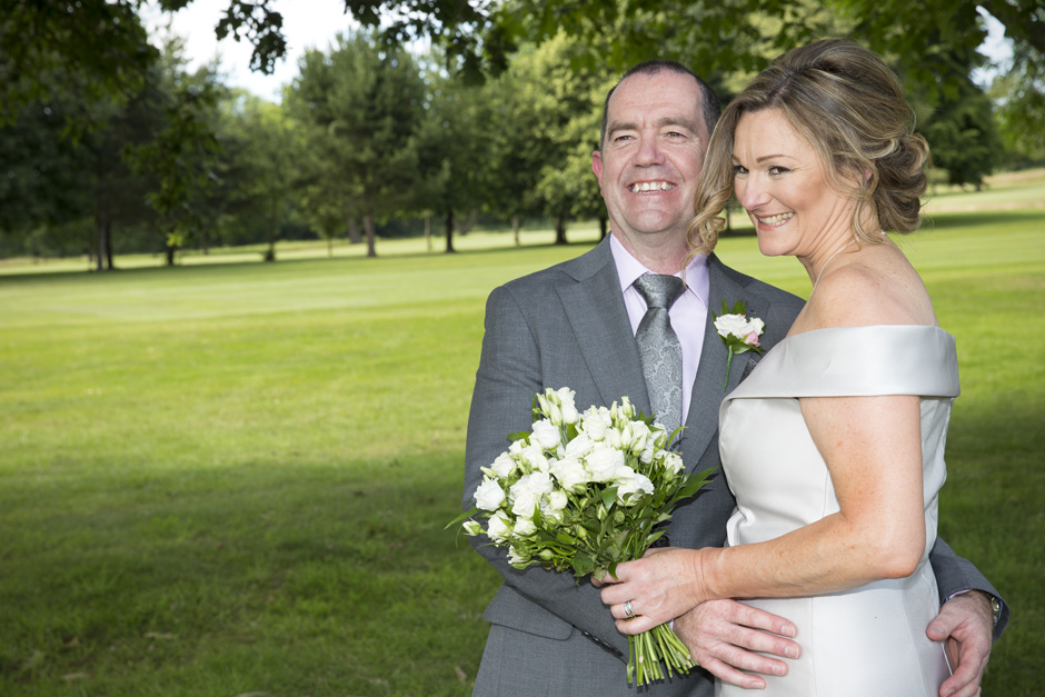 bride and groom embracing each other at their Weald of Kent wedding in Headcorn