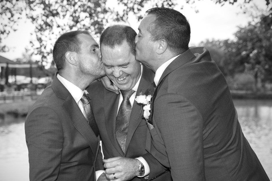 groom and groomsmen messing about at The Weald of Kent in Headcorn