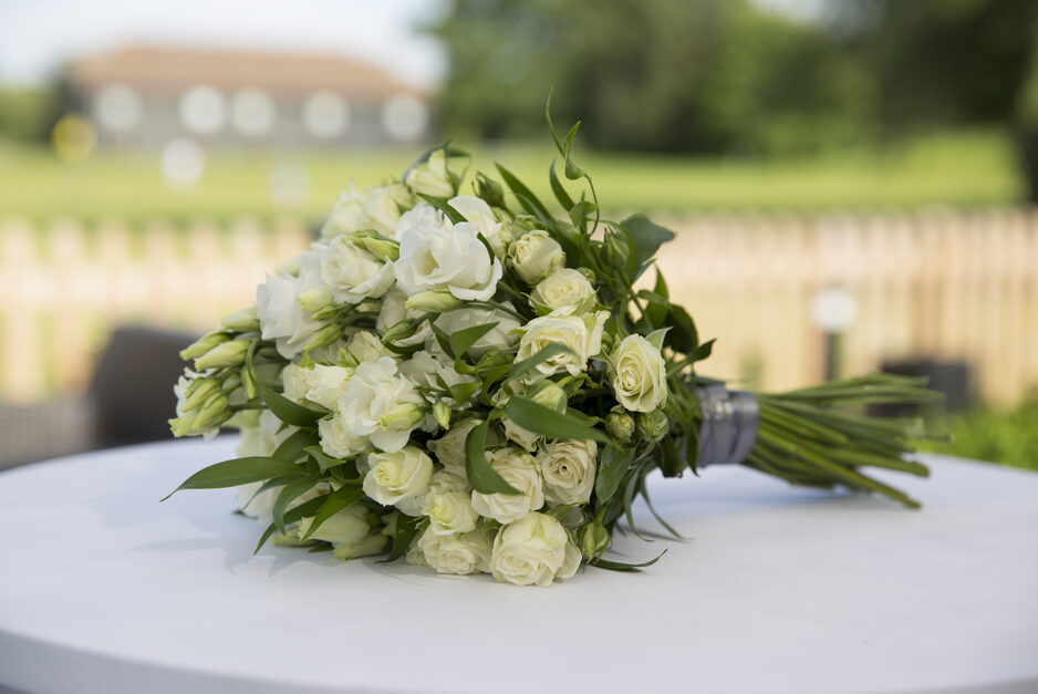 wedding bouquet with yellow and white roses at The Weald of Kent in Headcorn