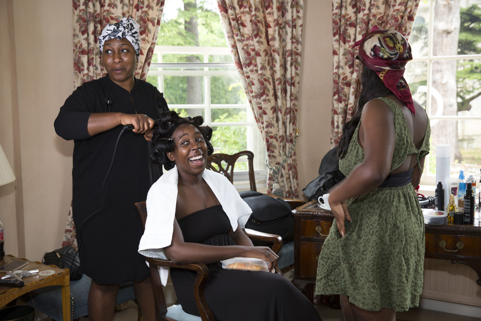 bride laughing as she is having her hair styled at The Old Rectory at Hartwell House in Buckinghamshire
