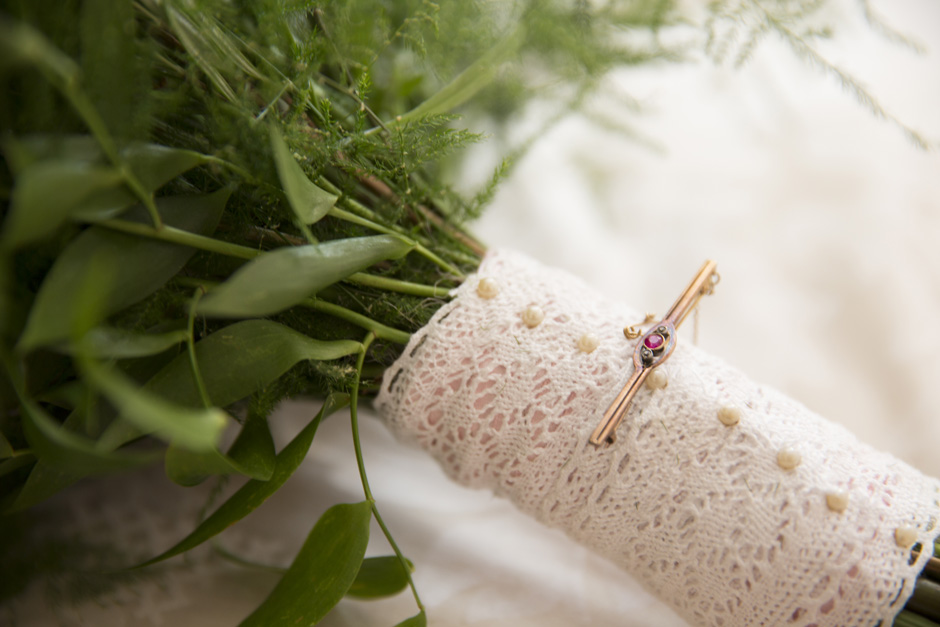 close-up on grandmother's brooch on wedding bouquet at Smarden village home in Kent