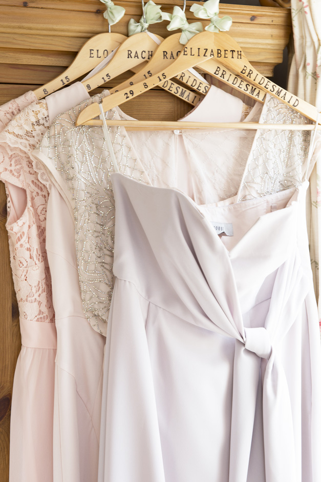bridesmaid dresses hanging on wooden personalised hangers at Smarden village home in Kent