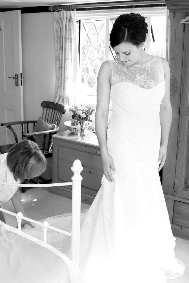 bride's mum checking dress at Smarden village home in Kent