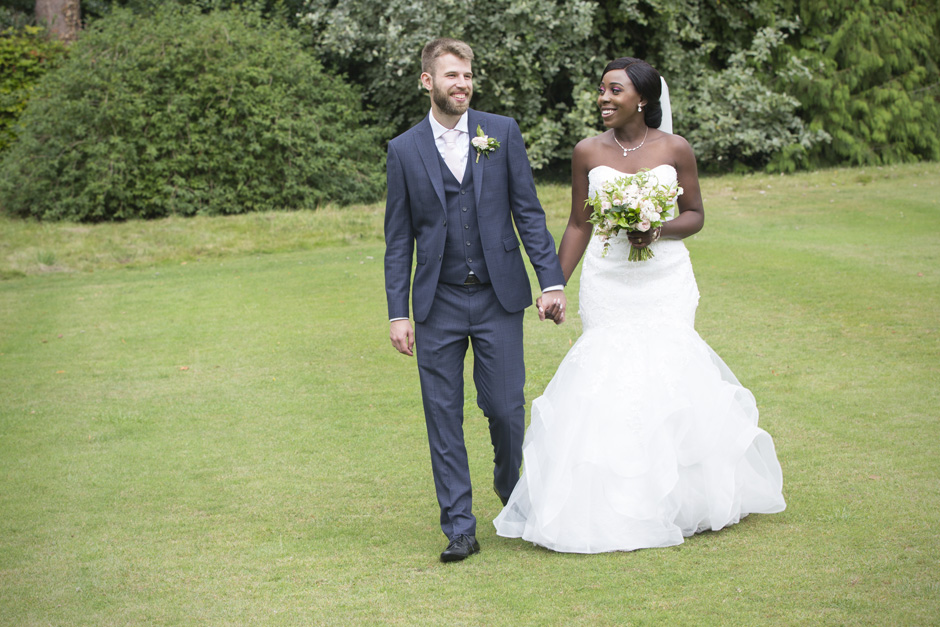 close-up of bride and groom walking around the grounds at Hartwell House in Buckinghamshire