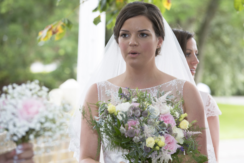 bride looking nervous taking a breath at St Michael the Archangel Church wedding in Smarden, Kent