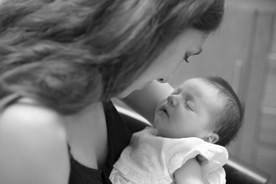 mother gazing upon sleeping newborn in Tonbridge, Kent