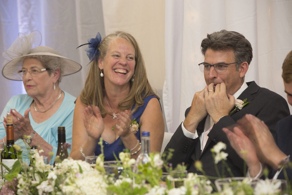 father of the groom wolf whistling during wedding speeches at Haddenham Village Hall in Buckinghamshire