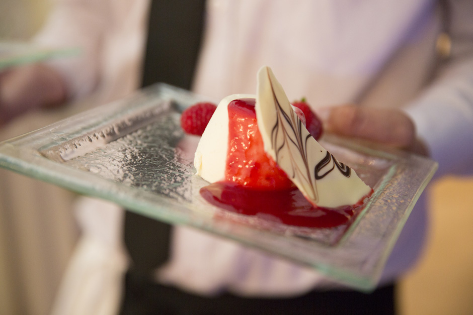 creme brulee with strawberries served with white chocolate at Smarden village home marquee wedding in Kent
