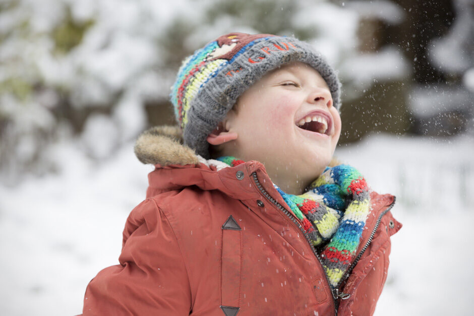 little boy looking excited playing in the snow in Tonbridge, Kent