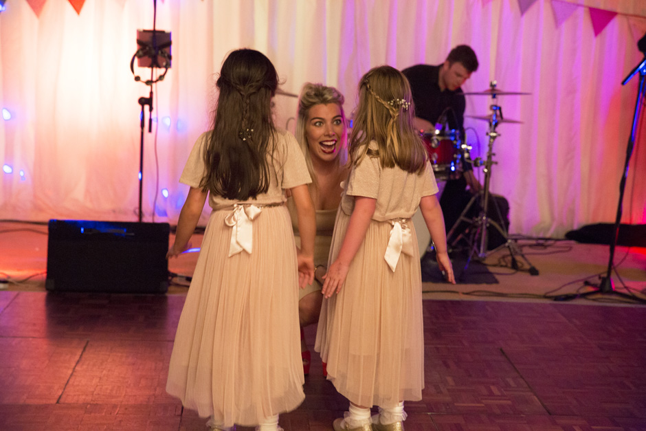 wedding singer chatting to flower girls at Smarden home marquee in Kent