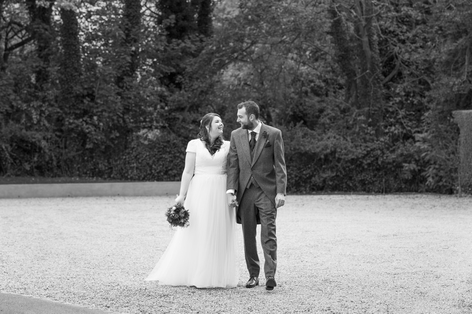 bride and groom walking around the grounds at The Little Hermitage in Rochester, Kent