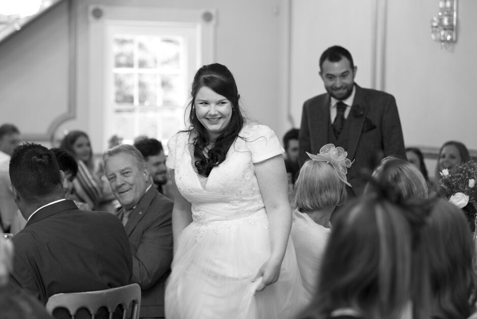 bride walking to her wedding breakfast to applause at The Little Hermitage in Rochester, Kent