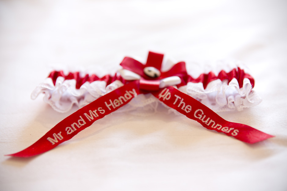Arsenal themed bridal garter labelled 'Mr and Mrs Hendy Up The Gunners' at Dale Hill Hotel in Ticehurst, East Sussex