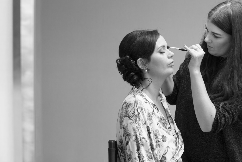 bride having eye shadow applied during bridal prep at Dale Hill Hotel in Ticehurst, East Sussex
