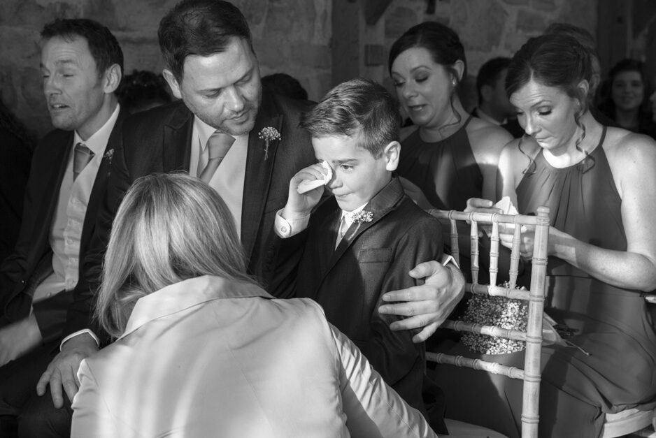 little boy best man crying with emotion during wedding ceremony at Swallows Oast at Ticehurst, East Sussex