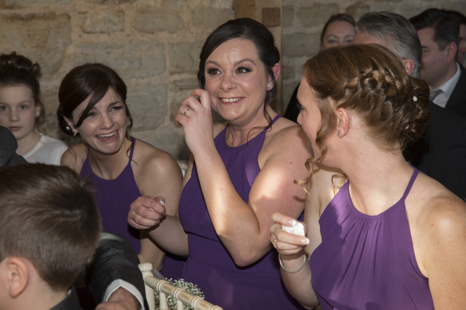 bridesmaid crying with emotion during wedding ceremony at Swallows Oast at Ticehurst, East Sussex