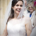 bride laughing with confetti in her hair outside Amersham Church, Bucks